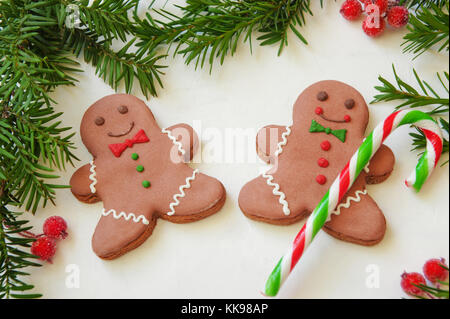 Winter holidays Christmas or New Year background with gingerbread cookies, fir tree. Copy space for your text. - Stock Photo