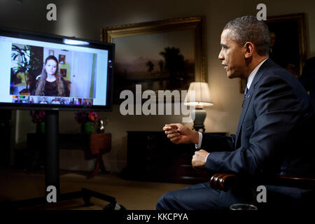 President Barack Obama participates in an interview with YouTube and Google+ to discuss his State of the Union Address, - Stock Photo