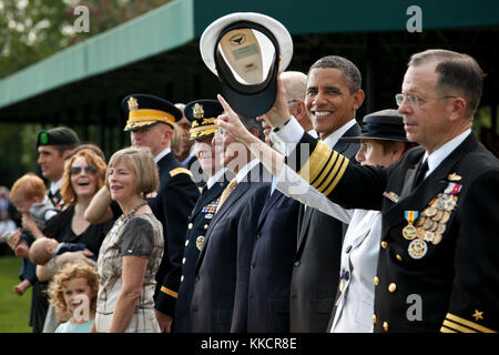 President Barack Obama participates in the Armed Forces farewell tribute to Admiral Mike Mullen, Chairman of the - Stock Photo