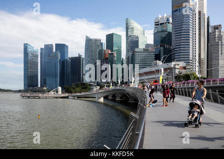 The skyline of modern Singapore photographed in July 2017 shot at Marina Bay. - Stock Photo