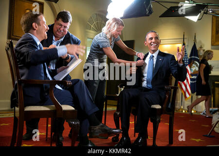 President Barack Obama participates in an interview with Chuck Todd, new host of NBC's 'Meet The Press' in the Cabinet - Stock Photo