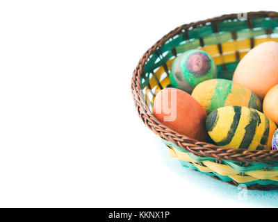 Funny Colorful Easter eggs hand painted by kids in basket isolated on white background. Copy space - Stock Photo