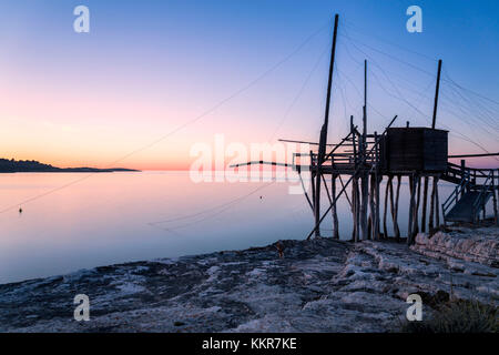 Trabocco ancient fishing machine typical of Gargano coast, Peschici village, Foggia district, Apulia, Italy - Stock Photo