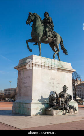 Bronze equestrian statue of King Louis XIV in Place Bellecour Central Lyon France Europe - Stock Photo