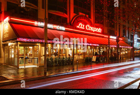 The famous cafe La Coupole decorated for Christmas at night, Paris, France. - Stock Photo