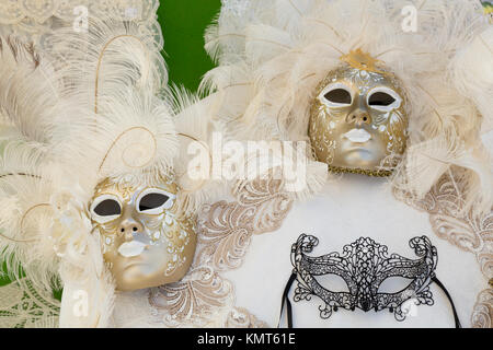 Closeup of masks in the Venetian vlllage of Burano, Venice, Italy, Europe. - Stock Photo