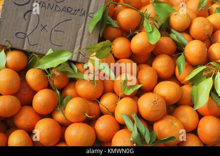 Valencia oranges stacked on market in mediterranean spain - Stock Photo