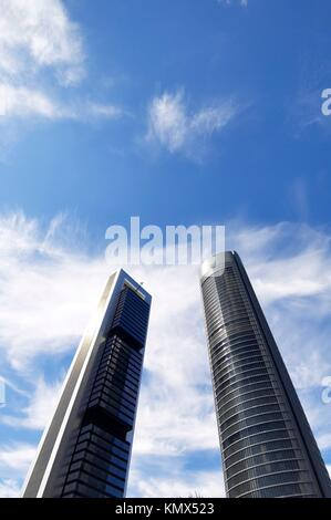 futuristic view of two skyscrapers in the city of Madrid, Spain - Stock Photo