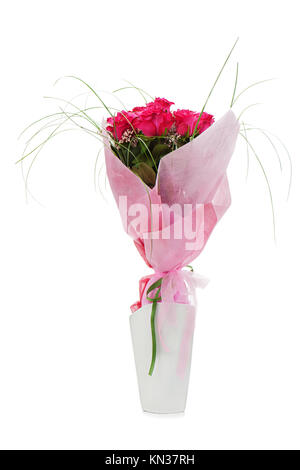 Colorful flower bouquet from red roses in white vase isolated on white background. - Stock Photo