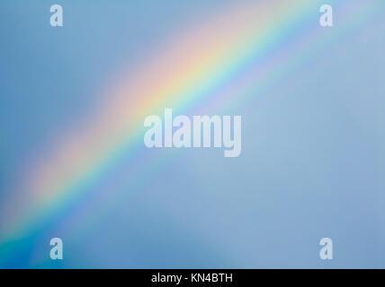 Rainbow on blue sky after rain. Stockholm, Sweden. - Stock Photo