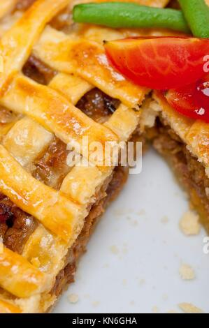 fresh baked home made beef pie macro closeup. - Stock Photo