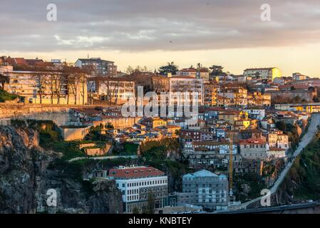 View on a building on a bank of Douro River in Porto city on Iberian Peninsula, second largest city in Portugal. - Stock Photo