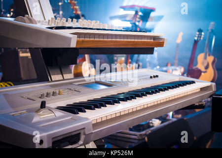 professional keyboards on guitars and light sunset - Stock Photo