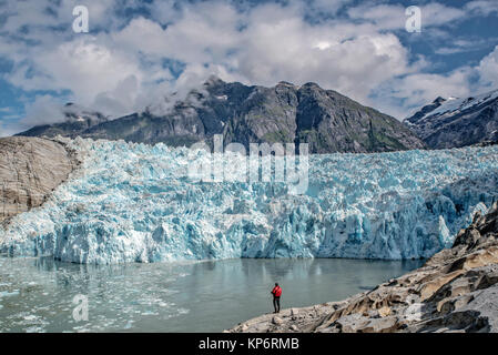 A hiker looks at out the LeConte Glacier at the Tongass National Forest Stikine-LeConte Wilderness September 1, - Stock Photo