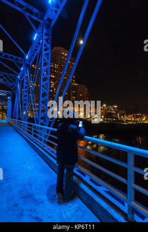 Night on the Blue Bridge over the Grand River in Grand Rapids, Michigan, USA - Stock Photo