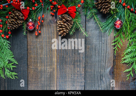 Christmas decorations and fir branches on wooden board background with copy space. - Stock Photo