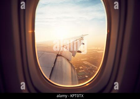 View from the window of the airplane at the sunrise. Landing in Bangkok, Thailand. - Stock Photo