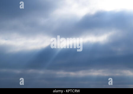 Sunlight filtering through the clouds. Natural visual effects. - Stock Photo