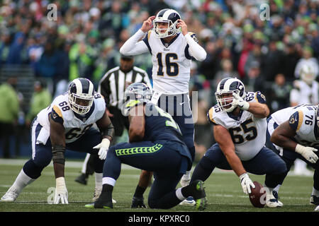 Seattle, WA, USA. 17th Dec, 2017. Los Angeles Rams quarterback Jared Goff (16) calls an audible before a play during - Stock Photo
