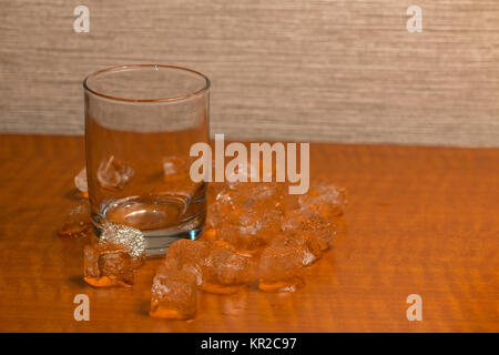 Ice Cubes Around an Empty Glass - Stock Photo