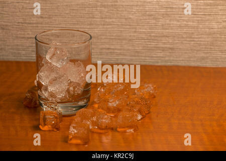 Empty Glass with Ice Cubes and More Around it - Stock Photo