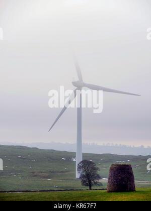 Brassington, Derbyshire. 19th December, 2017. UK Weather wind turbines turning in the cold mist near Brassington, - Stock Photo