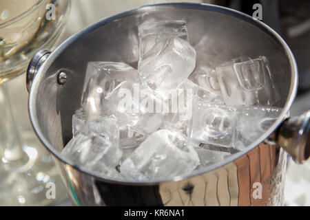 Bucket with ice cubes - Stock Photo