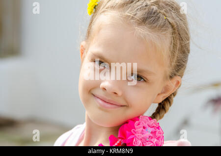 Close-up portrait of a beautiful six year old girl - Stock Photo