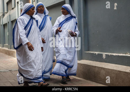 Missionaries of Charity sisters and nuns walking outside the Mother's House in Kolkata, India - Stock Photo