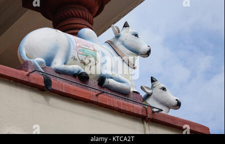 Sacred Hindu cow statue at the Sri Mariamman Temple in Singapore. - Stock Photo