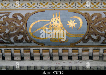 Ancient Ottoman patterned tile composition with some verses in Arabic from Holy Quran - Stock Photo