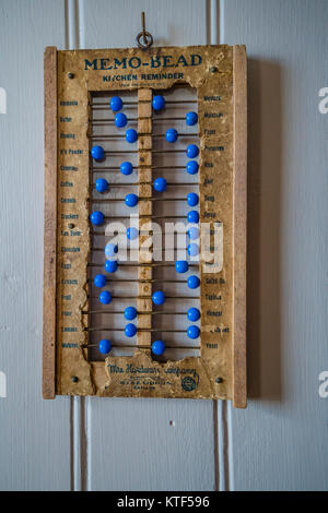 Memo-bead an antique kitchen reminder that resembles an abacus in the way it uses beads that slide along a wire. - Stock Photo