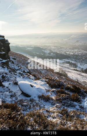 Snow covered abandoned millstone on Derwent edge in the Peak District, Derbyshire, England. - Stock Photo