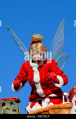Tinkerbell in the Christmas Parade at DisneyLand Paris EuroDisney. Santa outfit. Look of surprise on her face. Space - Stock Photo