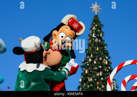 Christmas parade Disneyland Paris EuroDisney. Christmas tree and characters. Space for copy - Stock Photo
