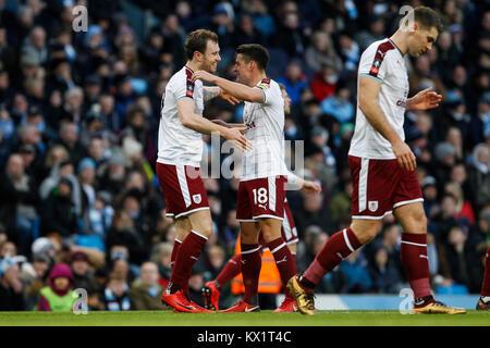 Manchester, UK. 06th Jan, 2018. Ashley Barnes of Burnley celebrates with Ashley Westwood of Burnley after scoring - Stock Photo