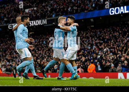 Manchester, UK. 06th Jan, 2018. Sergio Aguero of Manchester City celebrates with Oleksandr Zinchenko of Manchester - Stock Photo