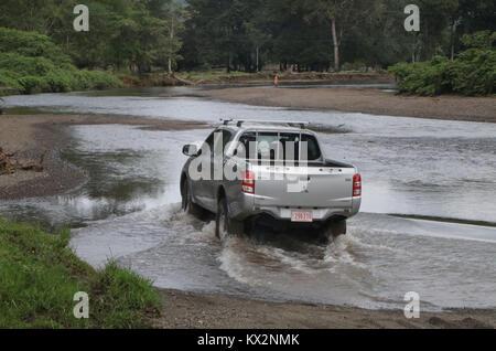 Car crossing river near Drake Bay Costa Rica Osa Peninsula - Stock Photo