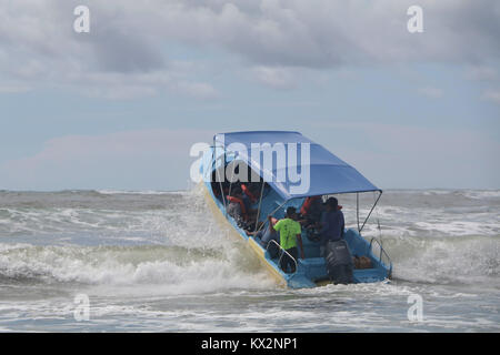 Boat with tourist jumping waves view from ocean Corcovado national Park Osa Peninsula Costa Rica - Stock Photo
