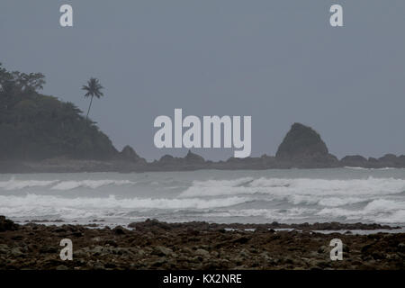 Hiker on beach Corcovado national Park Costa Rica Osa Peninsula - Stock Photo