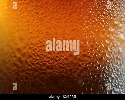 Macro shot of water drops texture on the deep orange color bottle, for abstract background with selective focus - Stock Photo