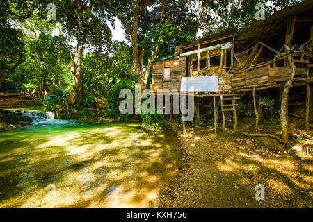 Old village house in Jamaica at day light - Stock Photo
