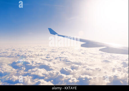 Amazing clouds and the sky as seen through the window of an aircraft - Stock Photo