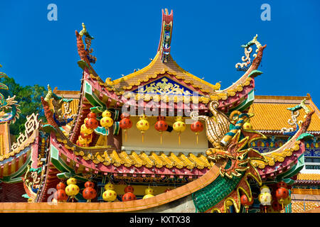 Close up of the roof of the Kek Lok Si Temple during Chinese New Year in Penang, Malaysia. - Stock Photo