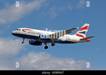 British Airways Airbus A319-131 G-EUOB landing at London,Heathrow - Stock Photo