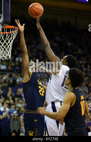 Seattle, WA, USA. 11th Jan, 2018. Cal Bear defender Kingsley Okoroh (22) attempts to block the shot of UW center - Stock Photo