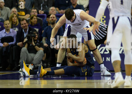 Seattle, WA, USA. 11th Jan, 2018. Cal center Kingsley Okoroh (22) protects the ball against UW center Sam Timmins - Stock Photo