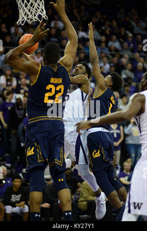 Seattle, WA, USA. 11th Jan, 2018. UW guard Jaylen Nowell (5) goes up for a shot against Cal defenders Darius McNeill - Stock Photo
