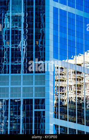 Modern architecture concept, skyscraper reflections in high rise building. Abstract highrise office buildings reflecting - Stock Photo