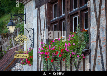 Ancient window and flower box on half-timbered building in Saint Cirq Lapopie, Lot Valley, Occitanie, France - Stock Photo